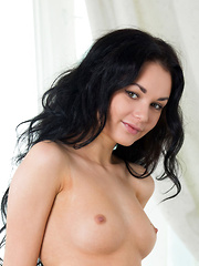Josephine's long and curly black hair draping over her sexy shoulders, spilling over her bare breasts, and framing her elegantly beautiful face as she showcases her smooth and slender legs and pretty feet