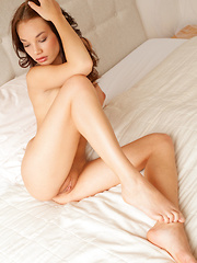 Nici Dee's slender naked body sprawled on top of the bed, with a breathtaking view of her sweet and ripe pussy, long, smooth legs, and beautiful puffy breasts.