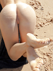 Viola A's magnificent large breasts takes the center stage as this buxom blonde poses by the beach.