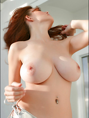 Danielle's curvy and oh-so-voluptuous body has always been one of our favorites, because that awesome bod of hers is topped off by a gorgeous face and huge gorgeously shaped all-natural DDD-cup breasts and the combination is breathtaking.